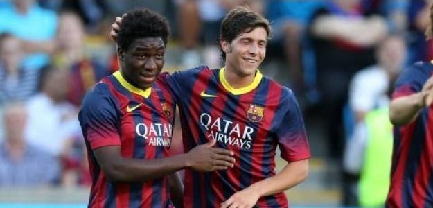 Jean Marie Dongou y Sergi Roberto celebran un gol en el FC Barcelona.